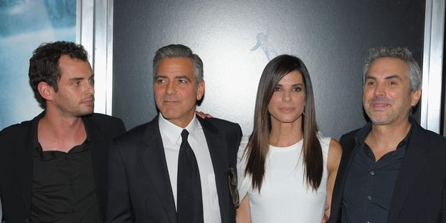 """Jonas Cuaron, George Clooney, Sandra Bullock and Alfonso Cuaron attend the """"Gravity"""" premiere on October 1, 2013 in New York City."""