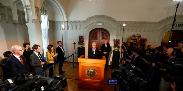 """The chairman of the Norwegian Nobel Committee, Thorbjorn Jagland, centre,  announces, the winner of the Nobel Peace Prize,  at the Nobel Institute,  in Oslo,  Friday Oct. 11, 2013. The Organization for the Prohibition of Chemical Weapons has won this year's Nobel Peace Prize, it was announced on Friday. The Norwegian Nobel Committee honored the Hague, Netherlands-based global chemical watchdog """"for its extensive efforts to eliminate chemical weapons.""""(AP Photo/ NTB Scanpix, Heiko Junge) NORWAY OUT"""
