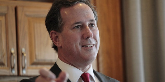 FILE 2016:  Rick Santorum visits with supporters at a house party in West Des Moines.