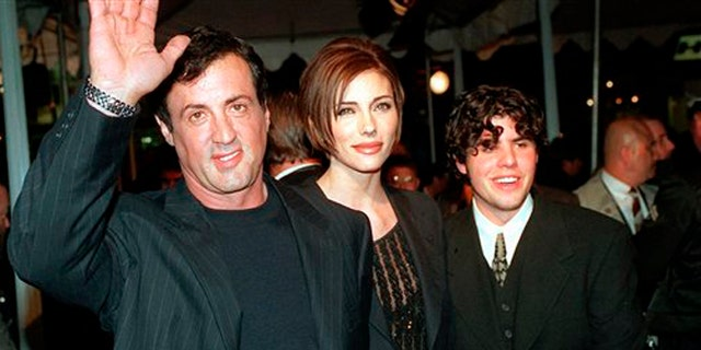 """Dec. 5, 1996: In this file photo, Sylvester Stallone, left, star of the film """"Daylight,"""" arrives at the film's world premiere with his girlfriend Jennifer Flavin, center, and his son Sage Stallone, who co-stars in the film, in Hollywood district of Los Angeles."""