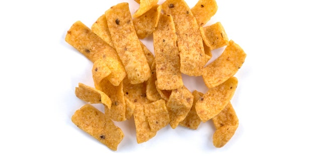 Tortilla corn chips on white background