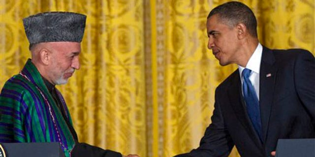 President Obama shakes hands with Afghan President Hamid Karzai during a news conference at the White House on May 12. (AP Photo)