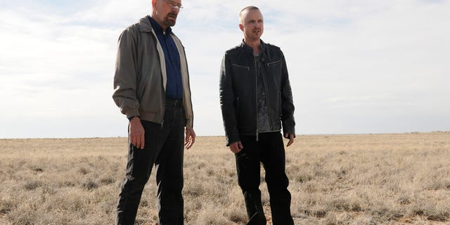 """FILE - This file image released by AMC shows Bryan Cranston as Walter White, left, and Aaron Paul as Jesse Pinkman in a scene from the season 5 premiere of  """"Breaking Bad."""""""