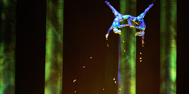 """In this Nov. 28, 2008, photo, Sarah Guyard-Guillot, left, and Sami Tiaumassi perform as """"Forest People"""" during Cirque du Soleil's """"Ka"""" at MGM Grand Resort in Las Vegas. Guyard-Guillot, a mother of two young children, was pronounced dead at a hospital late Saturday night, June 29, 2013, after falling about 50 feet from the show's stage during a performance of Cirque du Soleil's """"Ka."""""""
