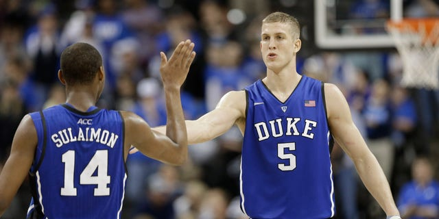 Duke's Mason Plumlee (5) is congratulated by teammate Rasheed Sulaimon (14) during the second half of an NCAA college basketball game against Wake Forest in Winston-Salem, N.C., Wednesday, Jan. 30, 2013. Duke won 75-70. (AP Photo/Chuck Burton)