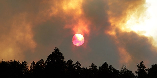 June 14: The sun sets behind smoke from the Wallow fire in Luna, N.M. The focus of the battle against the massive wildfire burning in eastern Arizona was on New Mexico as crews continued to light fires around the town of Luna to stop the flames.