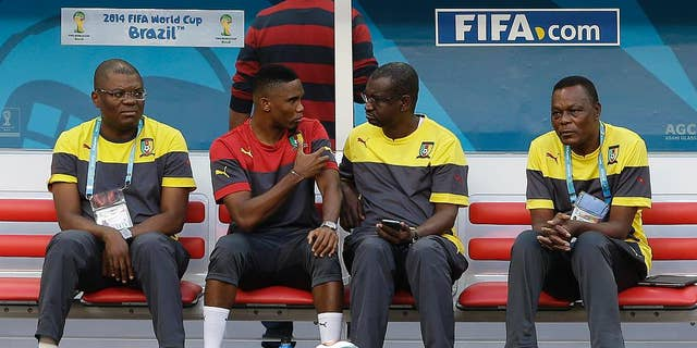Cameroon's Samuel Eto'o, second from left, talks with a member of his team during an official training session the day before the group A World Cup soccer match between Brazil and Cameroon at the Estadio Nacional in Brasilia, Sunday, June 22, 2014. Cameroon began the tournament with a 1-0 loss to Mexico and a 4-0 defeat to Croatia and they will want to leave the World Cup by beating the hosts. (AP Photo/Andre Penner)