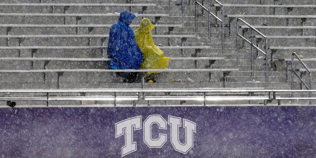 Fans sit in the stands during a thunder delay in the second quarter of an NCAA college football game between Texas and TCU, Saturday, Oct. 26, 2013, in Fort Worth, Texas. (Associated Press)