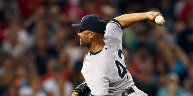 New York Yankees closer Mariano Rivera delivers during the ninth inning of a baseball game against the Boston Red Sox at Fenway Park in Boston, Friday, Aug. 5, 2011.