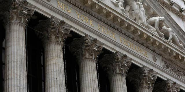 FILE - This Thursday, Oct. 2, 2014, file photo, shows the facade of the New York Stock Exchange. U.S. stock indexes edged slightly lower in early trading Friday, Feb. 27, 2015, after the U.S. economy slowed more sharply than expected in the final three months of 2014. Utilities stocks were among the biggest decliners. (AP Photo/Richard Drew, File)