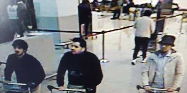 CCTV footage captured suspected airport bombers Najim Laachraoui, left, Ibrahim El Bakraoui and a mystery man in a dark hat.