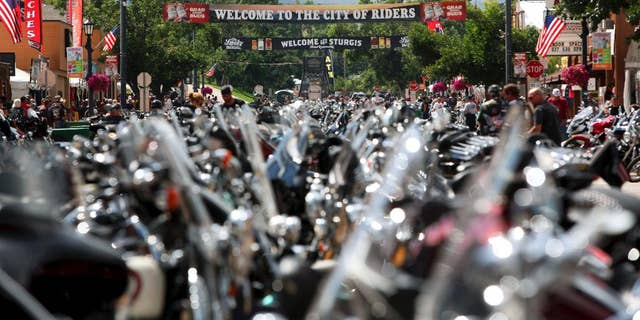 The city streets of Sturgis are lined with motorcycles days before the official kickoff of the annual Sturgis Motorcycle Rally in Sturgis, S.D on Aug 1, 2014. (AP Photo/Toby Brusseau, File)