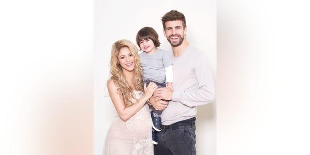 Shakira, Gerard Pique and son Milan pose for UNICEF World Baby Shower. (http://www.worldbabyshower.org/)