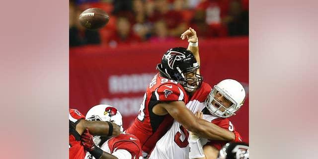 Atlanta Falcons cornerback Desmond Trufant (21) runs back a fumbled ball against the Arizona Cardinals during the first half of an NFL football game, Sunday, Nov. 30, 2014, in Atlanta. (AP Photo/Brynn Anderson)