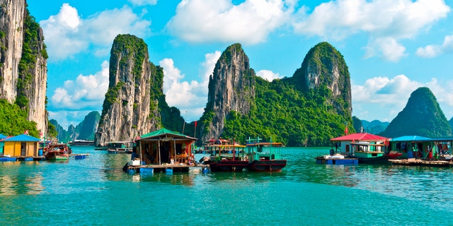 Floating village and rock islands in Halong Bay, Vietnam, Southeast Asia