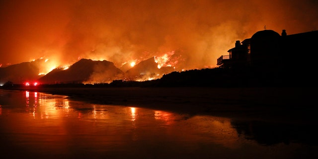 A wildfire burns along the 101 Freeway on Tuesday in Ventura, Calif.