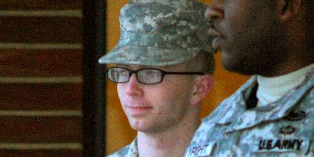 Dec. 17, 2011: Army Pfc. Bradley Manning, right, is escorted into a courthouse in Fort Meade, Md.