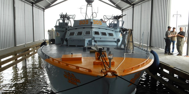 PT-305 docked in a facility built to house the boat along Lake Pontchartrain.