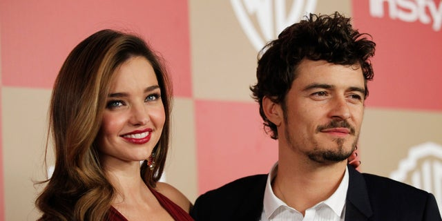 Actor Orlando Bloom (R) and model Miranda Kerr pose at the InStyle/Warner Bros. after party following the 70th annual Golden Globe Awards in Beverly Hills, California January 13, 2013. REUTERS/Mario Anzuoni (UNITED STATES - Tags: ENTERTAINMENT) (GOLDENGLOBES-PARTIES) - RTR3CFJY