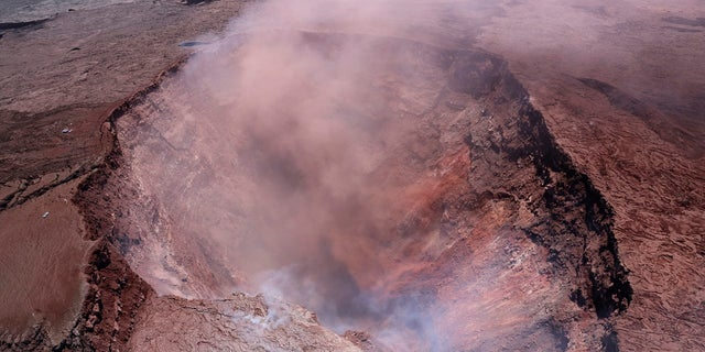 A plume of ash rises from the Puu Oo vent on Hawaii's Kilaueaa volcano.