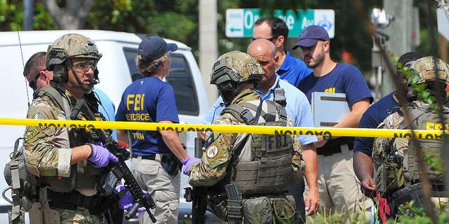 FBI, Orlando Police and personnel from the Orange County Sheriff's Office investigate the attack at the Pulse nightclub on June 12.
