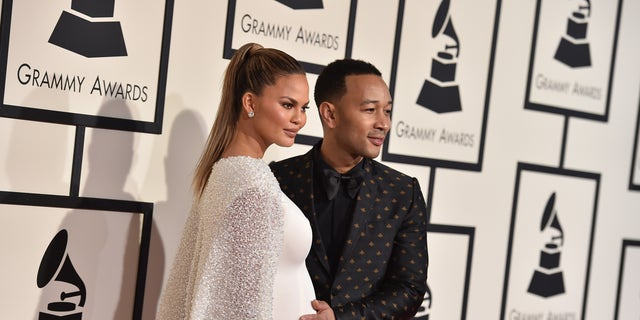 Chrissy Teigen, left, and John Legend arrive at the 58th annual Grammy Awards at the Staples Center on Monday, Feb. 15, 2016, in Los Angeles. (Photo by Jordan Strauss/Invision/AP)