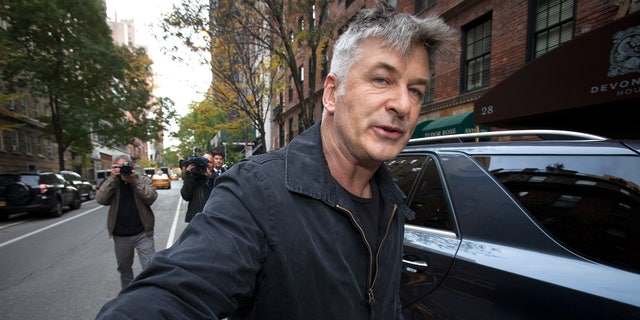 November 15, 2013. Actor Alec Baldwin shoves a photographer and tells him to move out of his way after he arrived in his SUV at the building where he lives in New York.