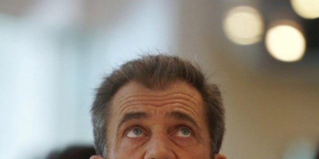 Actor Mel Gibson looks up while attending a charity fundraising event in Singapore in this September 13, 2007 file photo. The wife of Gibson filed for divorce on April 13, 2009 after 28 years of marriage, citing irreconcilable differences. REUTERS/Vivek Prakash/Files  (SINGAPORE ENTERTAINMENT HEADSHOT)