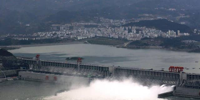 In this Nov. 7, 2008 photo, the flow of water is discharged through the Three Gorges Dam in Yichang in central China's Hubei province. State-owned China Three Gorges Group is spending heavily to buy or build hydro, wind and solar projects at a time when Western utility investors are pulling back and U.S. President-elect Donald Trump's pledge to revive coal use has raised doubt about U.S. support for renewables. (Chinatopix via AP)
