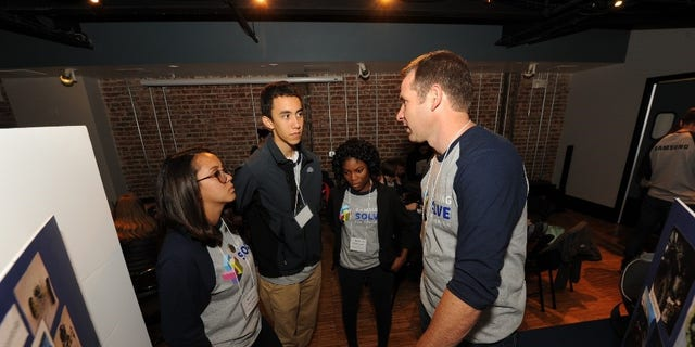 Teacher Michael Eilersten of Snowflake Junior High School speaks with other Solve for Tomorrow contestants about his classroom's project to create a low-cost wildlife detection system on Tuesday, April 25, 2017 in Washington, D.C.