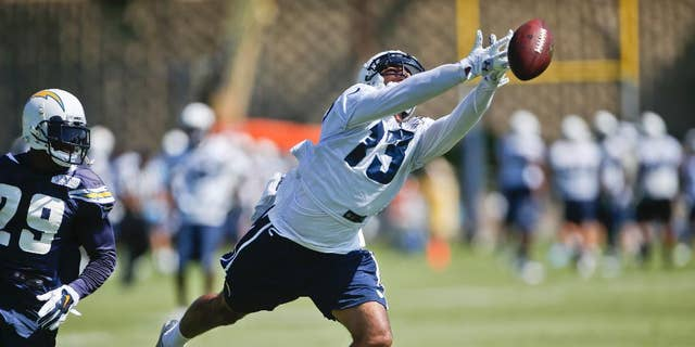 San Diego Chargers wide receiver Keenan Allen misses a finger tip catch during drills at a NFL football training camp Thursday, July 24, 2014, in San Diego.  (AP Photo/Lenny Ignelzi)