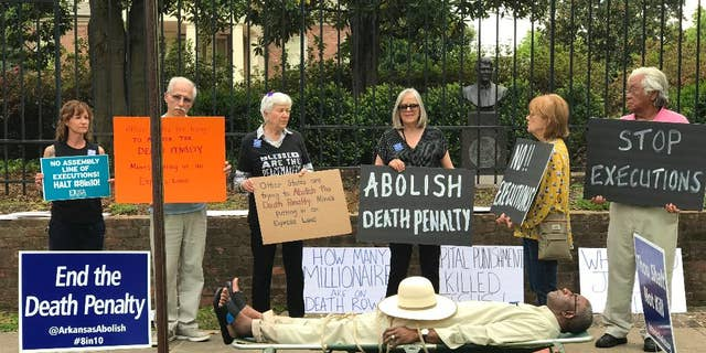 Pulaski County Circuit Judge Wendell Griffen, lying on cot, takes part in an anti-death penalty demonstration outside the Governor's Mansion in Little Rock, Ark., in April 2017. (Cheryl Simon via AP)