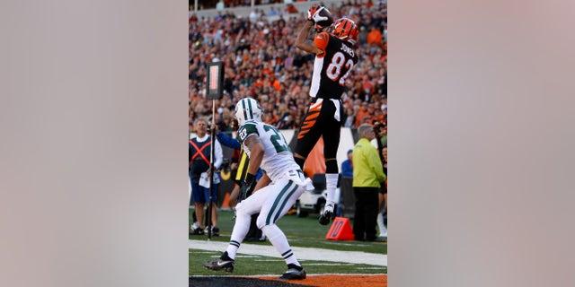 Cincinnati Bengals wide receiver Marvin Jones (82) catches a nine-yard touchdown pass against New York Jets cornerback Dee Milliner (27) in the first half of an NFL football game, Sunday, Oct. 27, 2013, in Cincinnati. (AP Photo/David Kohl)