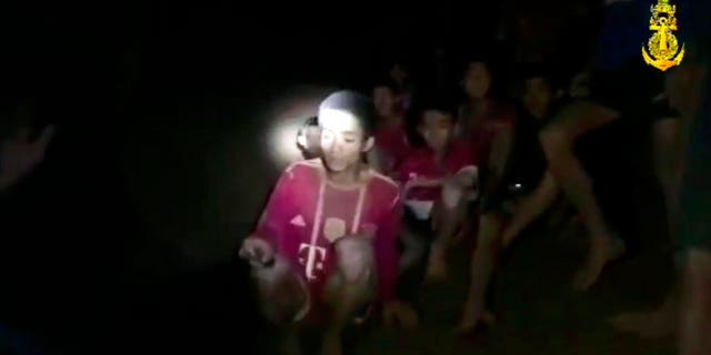 In this grab taken from video provided by the Thai Navy Seal, a view of the boys and their soccer coach as they are rescued in a cave, in Chiang Rai in Thailand, Monday, July 2