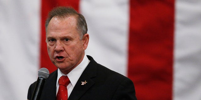 """FILE- In this Dec. 11, 2017, file photo, U.S. Senate candidate Roy Moore speaks at a campaign rally in Midland City, Ala.  Moore is telling supporters """"the battle is not over"""" in Alabama's Senate race as he asks for campaign donations and any reports of voting irregularities. Moore in a Friday, Dec. 15, fundraising email asked supporters to contribute to his """"election integrity fund"""" and tell them of any problems at the polls. (AP Photo/Brynn Anderson, File)"""