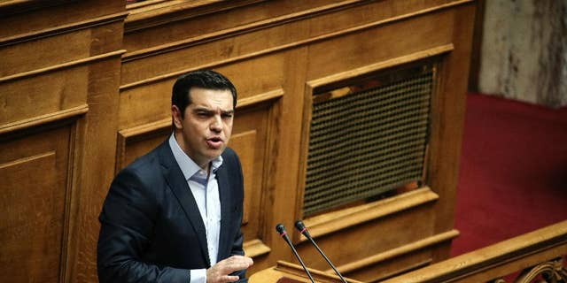Greece's Prime Minister Alexis Tsipras addresses lawmakers during a parliamentary session in Athens, Saturday, Dec. 10, 2016. Greek parliament votes on 2017 budget, as the country's left-wing government is still negotiating a new series of cost-cutting reforms that are expected to remove protection measures for private sector jobs and distressed mortgage holders. (AP Photo/Yorgos Karahalis)