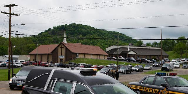 Hearses for six of the eight members of the Rhoden family found shot, in May 2016.
