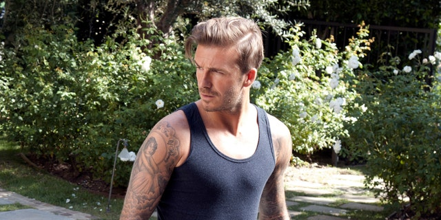 This October 2012 photo released by H & M shows soccer star David Beckham on the set of his newest ad campaign for his bodywear collection in Los Angeles. The ad is more like a film short, directed by Guy Ritchie. Beckham stars as an action hero, saving the day in Los Angeles in his boxer briefs and bedroom slippers.  (AP Photo/H&M)