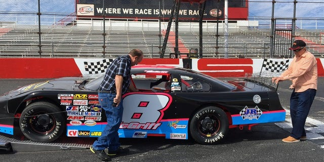 McGriff Sr.'s granddaughter is also racing on Saturday. McGriff Sr. and McGriff Jr. bring out her race car from the trailer.