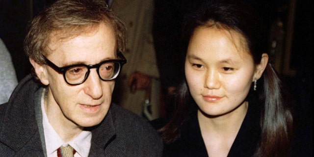 """Woody Allen and Soon-Yi Previn arrive for the premiere of Allen's movie, """"Everyone Says I Love You."""" — Reuters"""