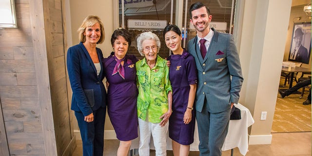 Surrounded by family, friends and airline staffers, Harmon was presented with an orchid and pinned with a new set of flight attendant wings