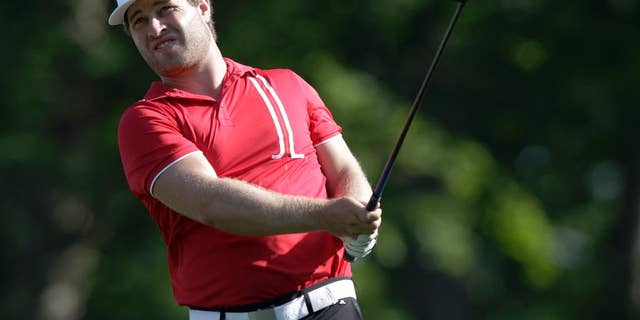 David Lingmerth, of Sweden, watches his approach shot on the ninth hole during the second round of the Memorial golf tournament, Friday, June 5, 2015, in Dublin, Ohio. (AP Photo/Jay LaPrete)