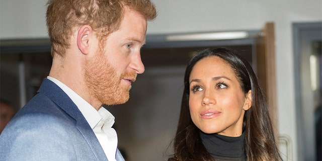 Britain's Prince Harry and his fiancee Meghan Markle visit the Nottingham Academy school on December 1, 2017.
