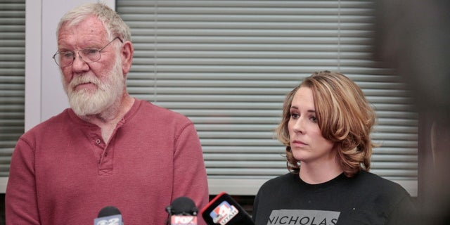 Bill Powell, Riley Powell's adoptive father, and Amanda Hunt, aunt of Breezy Otteson, listen to questions during a press conference on March 29.