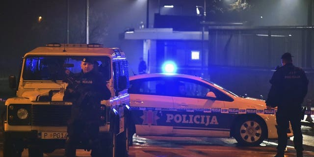Police block off the area around the U.S. Embassy in Montenegro's capital Podgorica, Thursday, Feb. 22, 2018.
