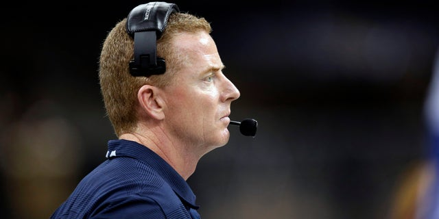 Dallas Cowboys head coach Jason Garrett watches from the sideline in the second half of an NFL football game against the New Orleans Saints in New Orleans, Sunday, Nov. 10, 2013. (AP Photo/Dave Martin)