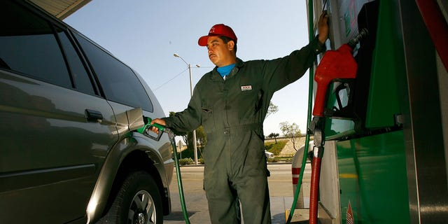 A Pemex gas station attendant filling up a car in Tijuana, Mexico.