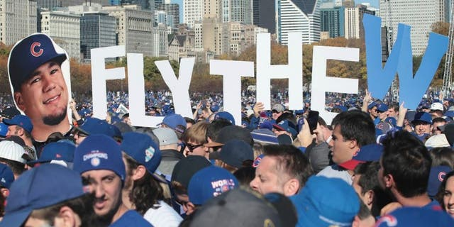 CHICAGO, IL - NOVEMBER 04: Chicago Cubs fans attend a rally in Grant Park to celebrate the team's World Series victory on November 4, 2016 in Chicago, Illinois. Hundreds of thousand of people lined the streets in downtown Chicago as the team paraded by in double deck buses on the way to the rally. (Photo by Scott Olson/Getty Images)