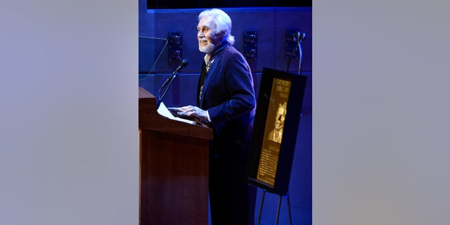 Country music star Kenny Rogers gives his acceptance speech at the ceremony for the 2013 inductions into the Country Music Hall of Fame on Sunday, Oct. 27, 2013.
