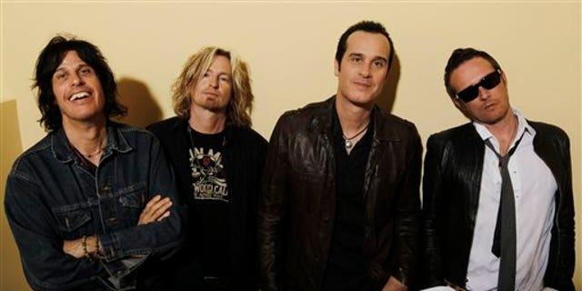 This April 30, 2010 file photo shows the Stone Temple Pilots, from left, Dean Deleo, Eric Kretz, Robert Deleo, and Scott Weiland from the band Stone Temple Pilots, pose for a portrait in Santa Monica, Calif.